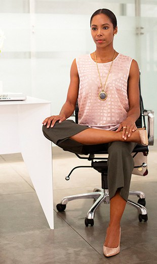 Photo of a woman doing the office chair hip stretch