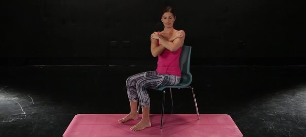 Photo of a woman completing the thoracic rotation stretch