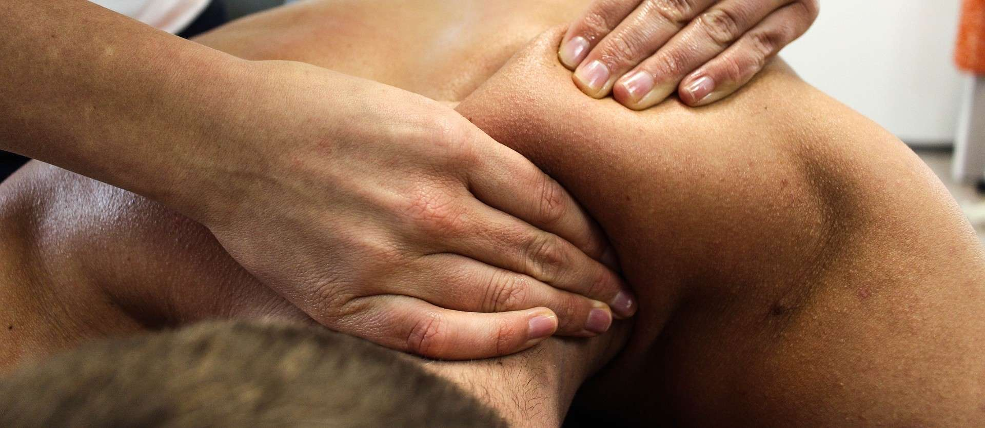 A photo of a man receiving a neck massage